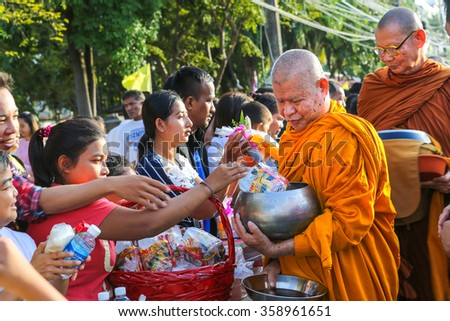 Songkhla, THAILAND â?? January 1, 2016 : Many people give food and drink for alms to Buddhist monks in new year day on January 1, 2016 in Songkhla, Thailand.