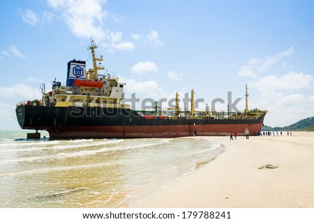 Songkhla, Thailand - March 01:Traveller sightseeing the Ships ORAPIN 4 is a liquefied natural gas tanker. The ship hit by Waves crashing ashore.On March 01,2014 at Samila Beach, Songkhla, Thailand.