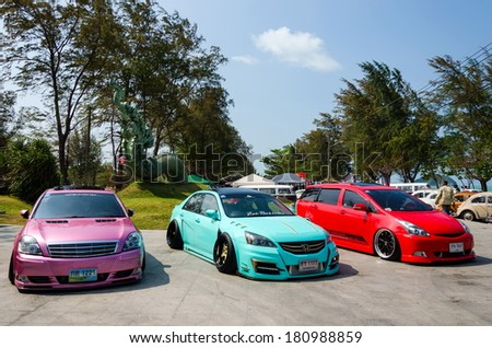 """SONGKHLA, THAILAND - March 09 : Tuned car show in """"Songkhla Car Club Show 2014"""" at Samila beach on March 09,2014 in Songkhla, Thailand. - stock photo"""