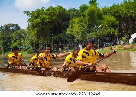 SONGKHLA, THAILAND-OCT 9: Unidentified rowers enjoy in Ku-Tao traditional boat festival on October 9, 2014 in Songkhla ,Thailand.,