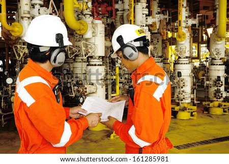 SONGKLA - JUNE 9: workers on offshore rig in gulf of Thailand from Songkra shore about 230 km, Thailand on June 9, 2008.  - stock photo