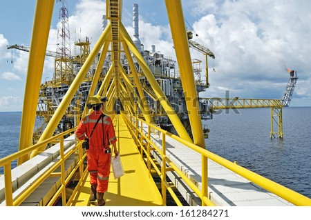 SONGKLA - OCTOBER 15: workers on offshore rig in gulf of Thailand from Songkra shore about 230 km, Thailand on October 15, 2008.  - stock photo
