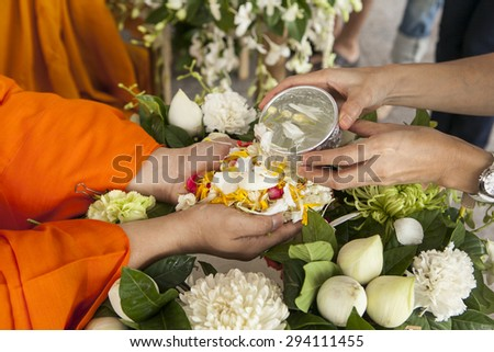 Songkran is thai tradition(thai new year), juniors pour water on the hands of revered elders and ask for blessing  - stock photo
