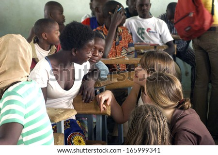 SONGRETENGA - BURKINA FASO - FEBRUARY 26, 2007: Visit of French schoolboy in Africa at the school of Songretenga. The pupils exchange their experiments between them. - stock photo