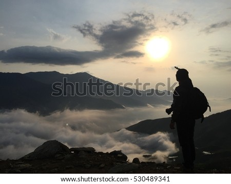 SonLa, VIetnam male traveler photographing in the mountain above clouds, Vietnam most view for travel checking on mountain.