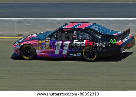 SONOMA, CA - JUNE 26: Denny Hamlin (11) at speed during 2011 Toyota/Save Mart 350 Commercial, the NASCAR Sprint Cup Series race on June 26, 2011 at the Infineon Raceway in Sonoma, CA. - stock photo