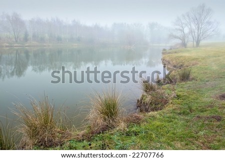 Soon morning near lake and fog - stock photo