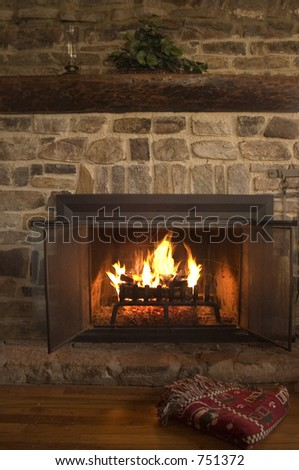 Soothing setting by a cabin fireplace - stock photo