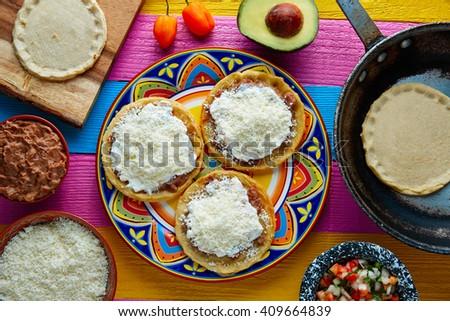 Sopes handmade mexican traditional food thick corn masa tortillas - stock photo