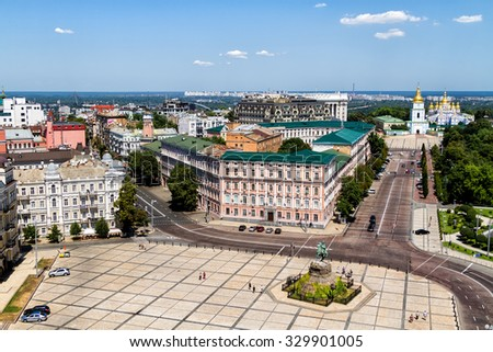 Sophievskaya Square. View from Bell tower of the Saint Sophia Cathedral. Kiev, Ukraine  St. Michael's Golden-domed monastery and Bohdan Khmelnitskiy monument in the background. - stock photo