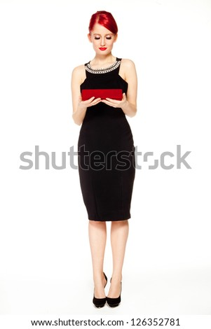 Sophisticated business woman with a jewellery box. - stock photo