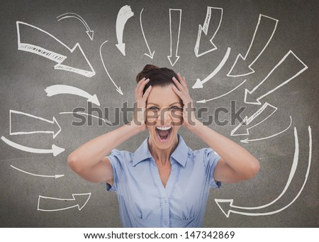 Sophisticated businesswoman screaming and holding her head