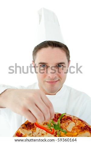 Sophisticated male cook holding a pizza against white background - stock photo
