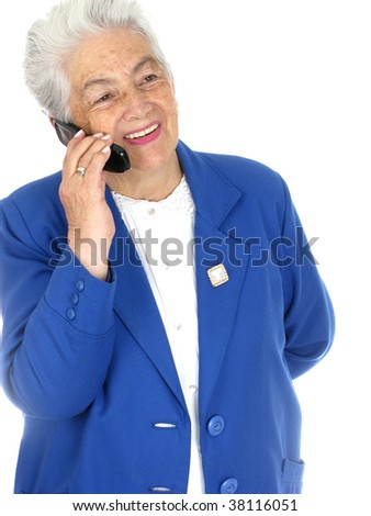 Sophisticated senior woman enjoying a cell phone conversation isolated over white background - stock photo
