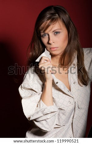 Sophisticated woman posing over red background - stock photo