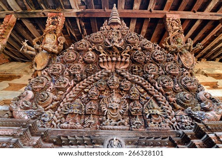 Sophisticated wooden carving on the hindu temple in Kathmandu, Nepal - stock photo