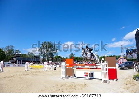 SOPOT - JUNE 12 : The international equestrian show-jumping - CSIO June 12, 2010 in Sopot, Poland. - stock photo