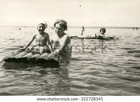 SOPOT, POLAND, CIRCA 1960: Mother and daughter enjoy sea - stock photo