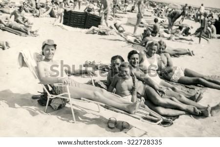 SOPOT, POLAND, CIRCA 1960: People enjoy summertime on beach - stock photo