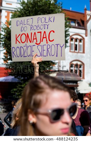 "Sopot, Poland, 2016 09 24 - protest against anti-abortion law forced by Polish government; people with banner saying: ""go on to work polish women - dying give births to orphans"""