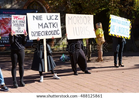 "Sopot, Poland, 2016 09 24 - protest against anti-abortion law forced by Polish government; people with banners"" people of PIS you'll go to hell for this law, do not teach mother how to give birth"