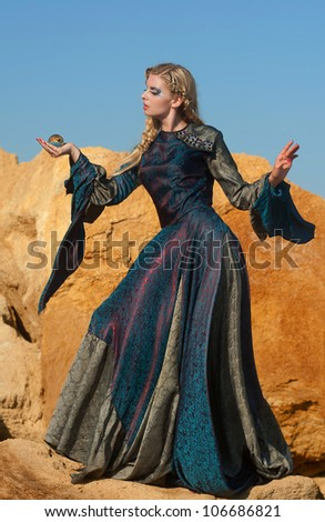 Sorceress with magic sphere - stock photo