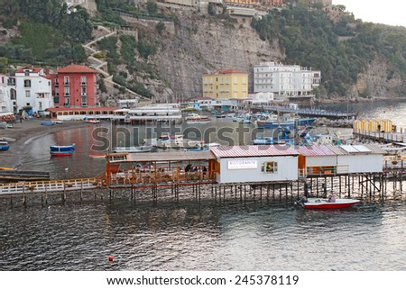 SORRENTO, ITALY - OCTOBER 8 2014: The port of Marina Grande at dusk. This ancient gateway to the city now contains numerous restaurants for tourists and still serves as an active base for fishermen.