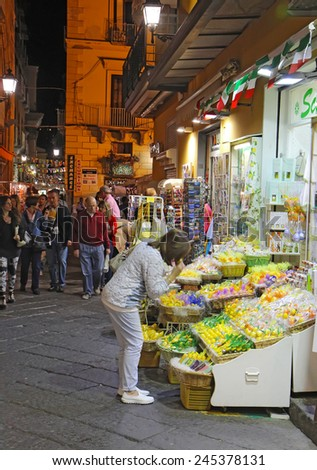 SORRENTO, ITALY - OCTOBER 9 2014: Tourists on Via San Cesareo in downtown Sorrento, Italy at night. This pedestrian shopping street is a popular destination for tourists to shop and visit restaurants.