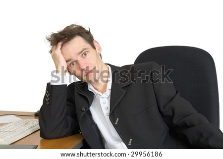Sorrowful businessman at the office, on a workplace - stock photo