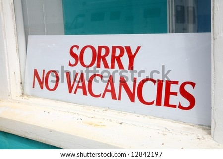 Sorry no vacancies sign in a guesthouse window. - stock photo