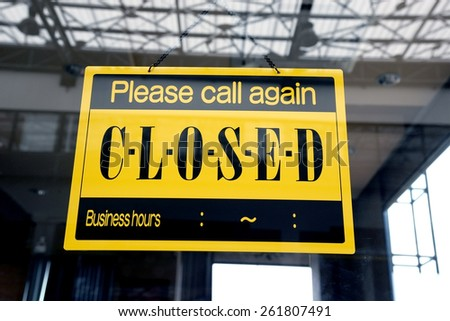 sorry we are closed sign hanging on a window door outside a restaurant, store - stock photo
