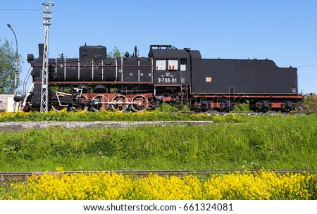 "SORTAVALA, RUSSIA - JUNE 14, 2017:  Photo of Soviet locomotive ""ER-788-81"" - a monument at the railway station."
