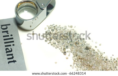 Sorting of gems - diamonds and loupe over white - stock photo
