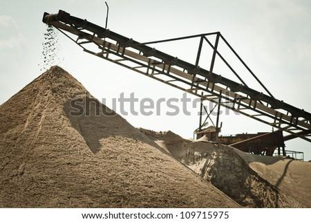 Sorting sand belt - stock photo