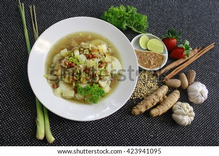 Soto Sabrang. Soto is a traditional Indonesian soup, Composed of broth, meat & vegetables. Soto Sabrang originally from Madura. Sabrang means Singkong in Bahasa, & Cassava in English. Hig top view. - stock photo