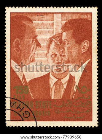 SOUDI ARABIA - CIRCA 1967: A stamp printed in Mahra State of Saudi Arabia shows three men discussing, circa 1967 - stock photo
