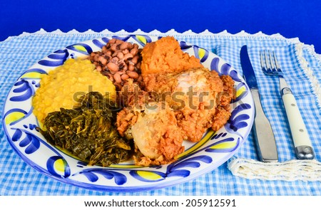 Soul Food supper in blue gingham Southern Cooking setting. - stock photo
