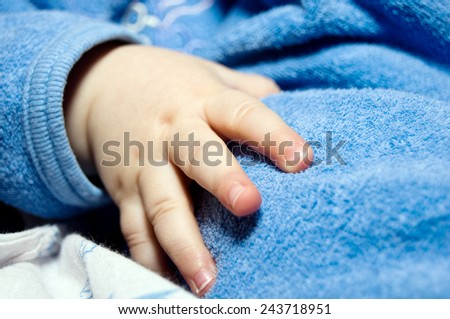 Soul-stirring adorable child's hand close-up - stock photo