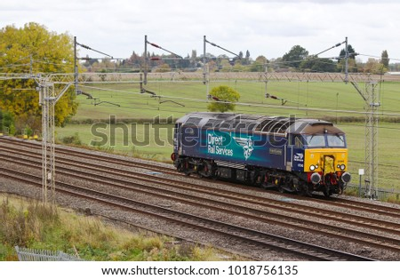 SOULBURY, UK - OCTOBER 19: A vintage class 57 diesel loco operated by DRS makes a light movement to Norwich TRSMD having delivered coaches for refurbishment on October 19, 2015 in Soulbury