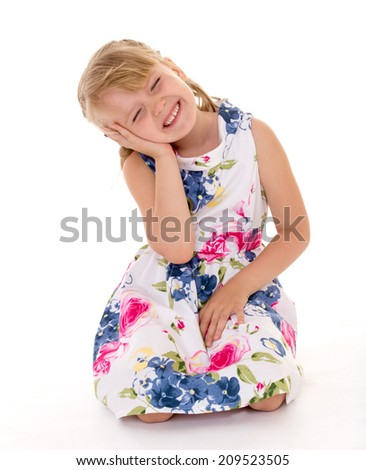 Soulful little girl.Isolation on a white background. - stock photo