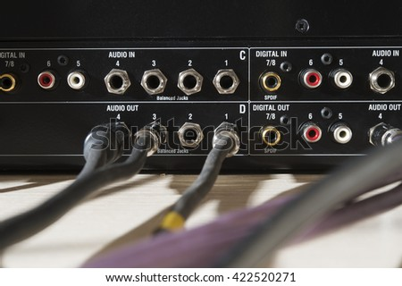 sound and free wires and jacks in the sound panel - stock photo