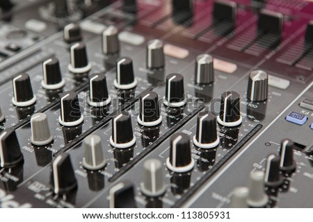 Sound and voice controlling equipment for professional disc jockey - stock photo