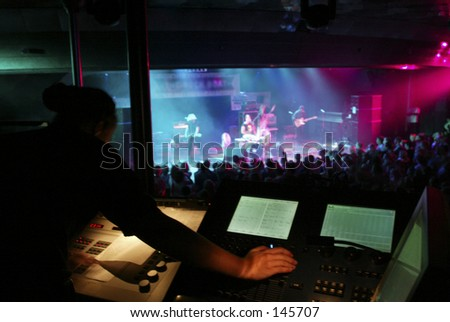 Sound Board Technician at a Concert