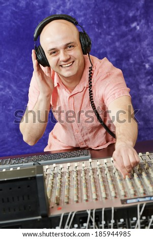 sound engineer work with faders and knobs on professional audio musical mixer - stock photo