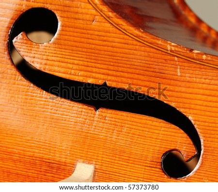 Sound hole of an antique hand-crafted cello - stock photo