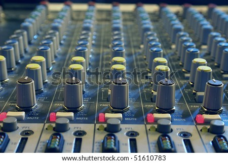 Sound mixer, closeup of the knobs. - stock photo