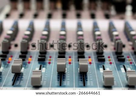 Sound mixer control panel, close-up of audio controls. - stock photo