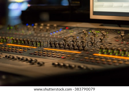 Sound mixer controller with knobs and sliders - stock photo
