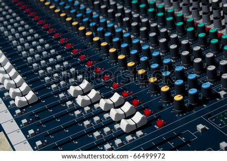 Sound mixer, low angle shot with shallow DOF, useful for various music and sound themes - stock photo