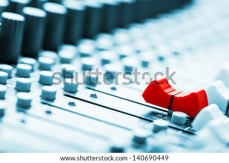 Sound mixer, red fader ahead